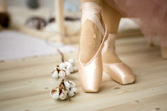 Pointe Ballet Shoes. New pink ballet pointe shoes on vintage wooden background stock image