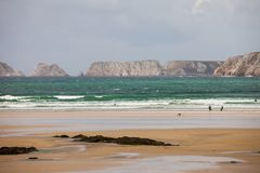 Pointe de Pan Hir and surfers. Pointe de Pen Hir in Brittany, Finistere, France Royalty Free Stock Photo