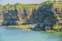 The pointe du Hoc. The limestone cliffs of Pointe du Hoc Stock Photo