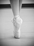 Pointe Shoes. Black and white dancer on pointe shoes on toe royalty free stock image