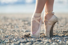 Pointe shoes on the beach Stock Image