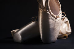 Pointe Shoes. Over black background royalty free stock photo