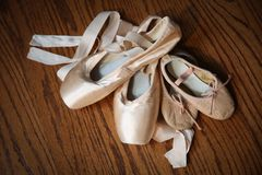 Pointe Shoes with Small Ballet Slippers Stock Photography