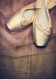 Pointe Shoes. On wooden background stock photos