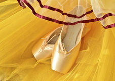 Pointe shoes and yellow tutu Stock Photography