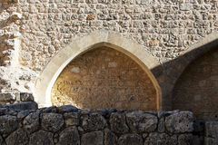 Pointed arches, stone walls, middle ages Stock Image