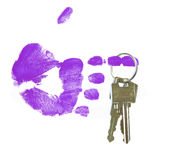Pointed hand holding set of keys. Finger painted hand holding out set of keys Royalty Free Stock Image