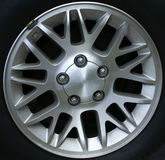 Pointed Rim. A chrome rim with many points on an automobile Royalty Free Stock Photos