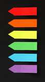 Pointed Sticky Notes on a Black Background Royalty Free Stock Photo