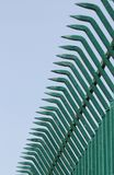 Pointed wrought iron bars forged to form a fence Stock Photo