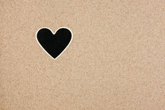 Pointer, ads board in the form heart  in the sand Royalty Free Stock Photography
