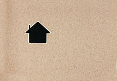 Pointer, ads board in the form house  in the sand Royalty Free Stock Photos