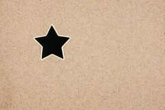 Pointer, ads board in the form star in the sand Stock Photography