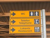 Pointer in airport. Pointer  to turetskom airport, pokaz�vayuschyy direction k toilet, telephone and Restaurant Stock Photography