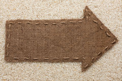 Pointer of  burlap lies on  rice  grain Stock Photography