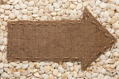 Pointer of  burlap lies on sunflower seeds Royalty Free Stock Photos
