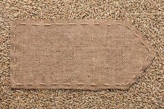 Pointer of burlap lying on a rye background Royalty Free Stock Images