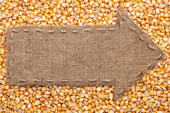 Pointer of burlap with place for your text, lying on a corn Stock Photography