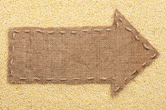 Pointer of burlap with place for your text, lying on a millet Royalty Free Stock Images
