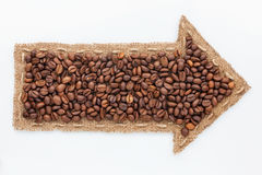 Pointer with coffee  grains Royalty Free Stock Photography