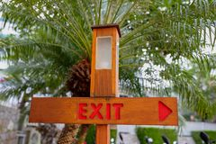Pointer Exit with a lantern on a background of a palm tree royalty free stock photography