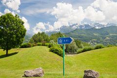 The pointer of highway in mountains Royalty Free Stock Image