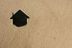 Pointer house  in the sand Royalty Free Stock Photo