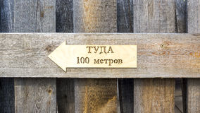 Pointer icon with text - this way 100 meters Stock Photography