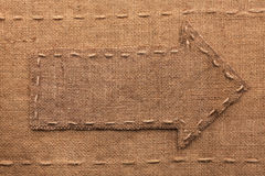 Pointer made of burlap, lying on sackcloth Stock Image