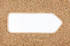 Pointer made from rope with grains rye lying on a white background Royalty Free Stock Photos