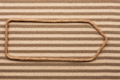 Pointer made of rope on the sand Stock Photo