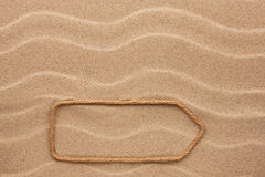 Pointer made of rope on the sand Royalty Free Stock Photography