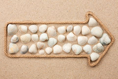 Pointer made of rope with sea shells Royalty Free Stock Images