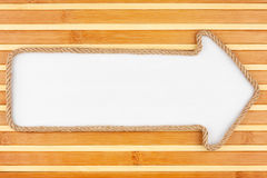 Pointer made of rope with a white background on the bamboo mat Royalty Free Stock Photo