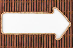 Pointer made of rope with a white background on the bamboo mat Royalty Free Stock Image