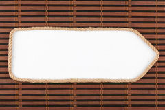 Pointer made of rope with a white background on the bamboo mat Stock Photos