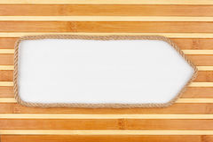 Pointer made of rope with a white background on the bamboo mat Royalty Free Stock Photography