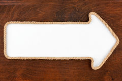 Pointer made of rope with a white background on the wood Stock Photos