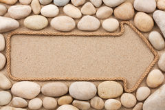 Pointer made of rope with white stones Royalty Free Stock Images