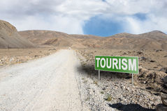 Pointer on mountain road in Tajikistan. Pamir highway Royalty Free Stock Photography