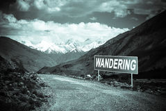 Pointer on mountain road in Tajikistan. Pamir highway. Toned Royalty Free Stock Photos