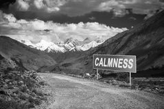 Pointer on mountain road in Tajikistan. Pamir highway. Toned Royalty Free Stock Photography