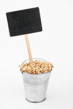 Pointer, price in bucket of  barley grains Stock Image