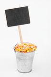 Pointer, price in bucket of  corn grains Stock Images