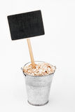 Pointer, price in bucket of  oat flakes Royalty Free Stock Image
