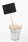 Pointer, price in bucket of  sesame seeds Royalty Free Stock Photo