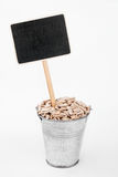 Pointer, price in bucket of  sunflower seeds Royalty Free Stock Photography