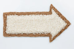 Pointer with rice grains Royalty Free Stock Image