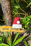 Pointer to the diving center christmas hat Stock Photo