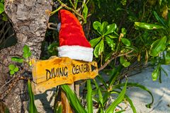Pointer to the diving center christmas hat Royalty Free Stock Image